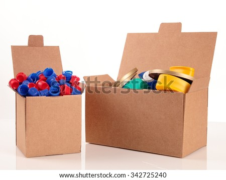 a paperboard box with a lot of caps for recycle on a white background