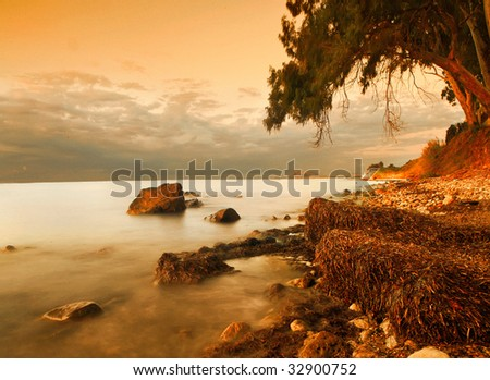 A paradise landscape in gold tones of coast Terens sea. Sicily island.