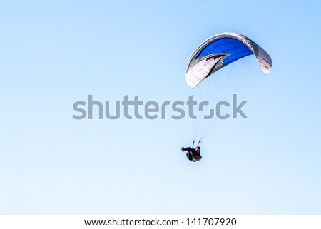 A paraglider - stock photo