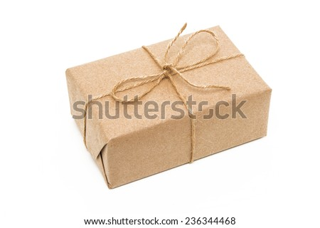 A parcel wrapped in brown paper and tied with rough twine