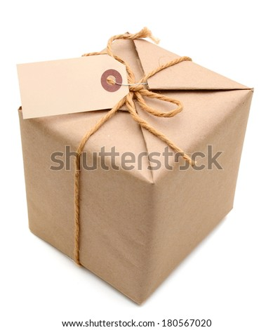 A parcel wrapped in brown paper and tied with rough twine and blank label  - stock photo