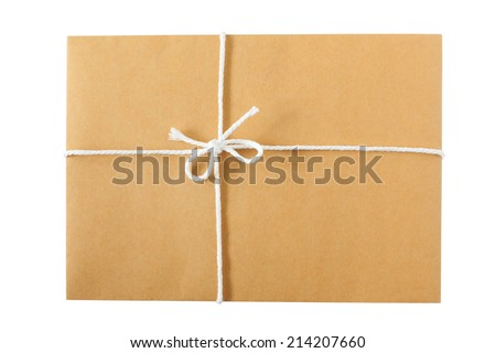 A Parcel Wrapped Tied with Rope on a white background - stock photo