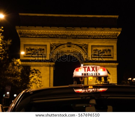 A Parisian taxi near Arc de Triomphe in Paris. - stock photo