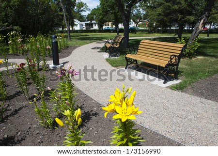 A park banch and flower in hot summer day - stock photo