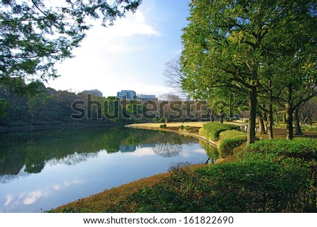 A park within a city with a body of water and well-tended landscaping. - stock photo