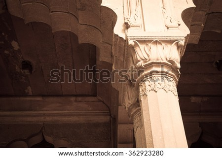 A part of a decorated Mughal column in the red fort of Delhi in India