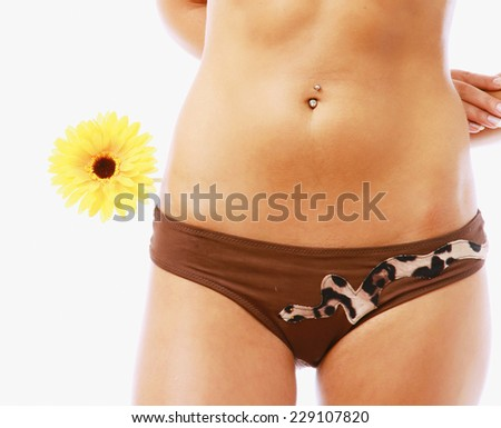 A part of a female body and a flower, isolated on white - stock photo