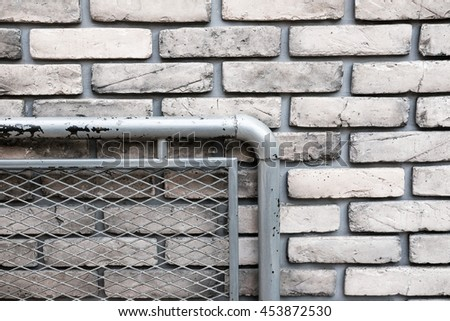 A part of iron net on vintage brick wall, vintage tone - stock photo