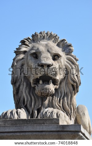 A particular of a lion statue on the Chain Bridge in Budapest - stock photo