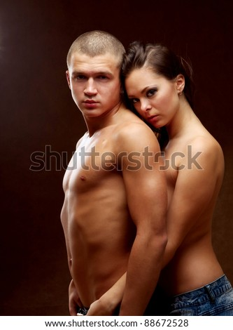 A passionate couple, side-view - stock photo