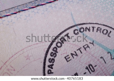 A passport control stamp in a British passport - stock photo