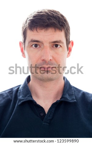 A passport photo of a late thirties white male in a dark blue polo shirt. - stock photo