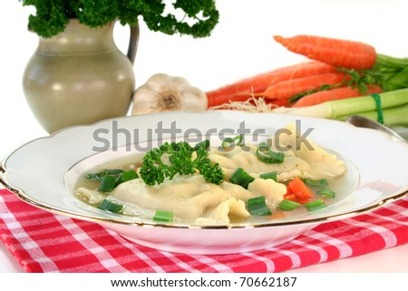 a Pasta squares soup with fresh vegetables and parsley