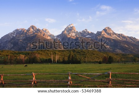 a pastoral scene on a ranch at the base of the Tetons - stock photo