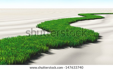a path made of lawn that grows in a desert of sand, winds toward a unknown destination in a sunny day - stock photo