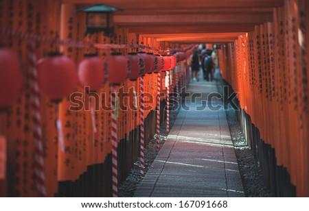 A pathway of 1000 gates at Fushimiinari Taisha Shrine, Kyoto, Japan - stock photo