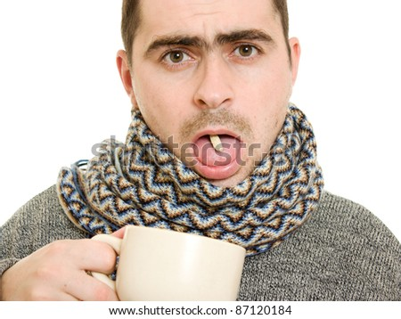 A patient man with a cup and the pill on a white background. - stock photo