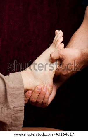 A patient receives a foot massage and stimulation of acupressure points