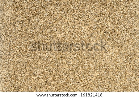 A pavement made of small sandy pebbles. - stock photo
