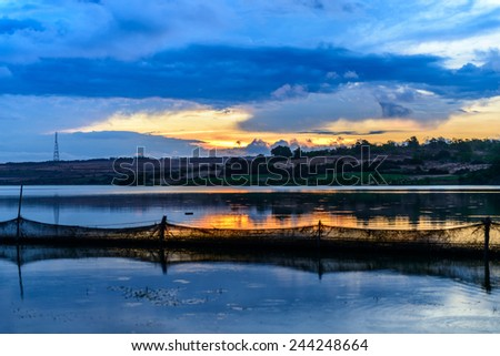 A peaceful lagoon at sunset - stock photo