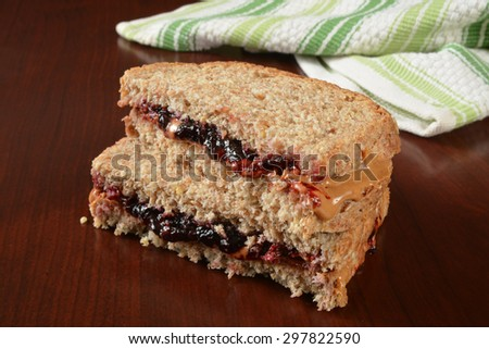 A peanut butter and jelly sandwich cut in half