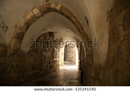 A pedestrian arched tunnel in the Jewish quarter of the old city of Jerusalem, Israel. - stock photo