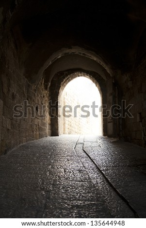 A pedestrian arched tunnel in the Jewish quarter of the old city of Jerusalem, Israel.