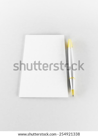 a pen and a paper on the white background - stock photo