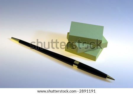 A pen and post-it - stock photo