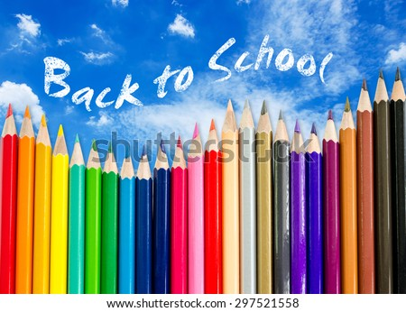 A pencil crayon border on blue sky background with words back to school. save clipping path - stock photo