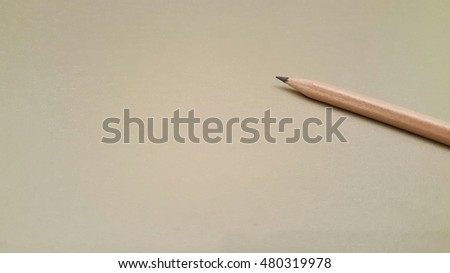 a pencil isolated on desk background in conference room, smooth tone
