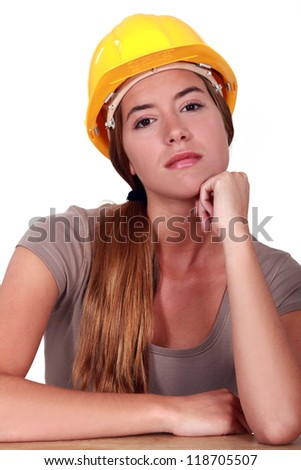 A pensive female manual worker.