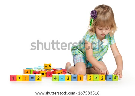 A pensive little girl is playing on the floor on the white background - stock photo