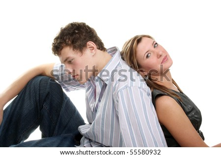 a pensive young man near his girlfriend - stock photo