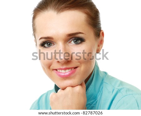 A pensive young woman at the desk - stock photo