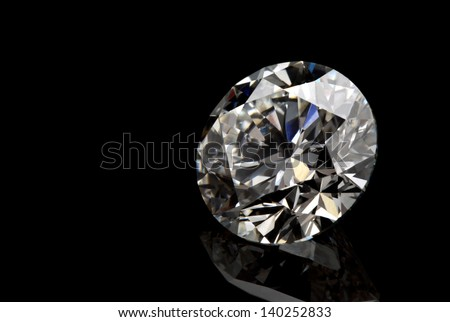 A perfect cut of diamond isolated on black background.
