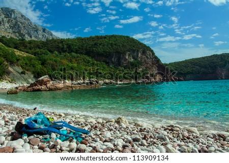 A perfect snorkeling place, on a rocky beach on the Mediterranean Sea, near Sveti Stefan/ Snorkeling beach - stock photo