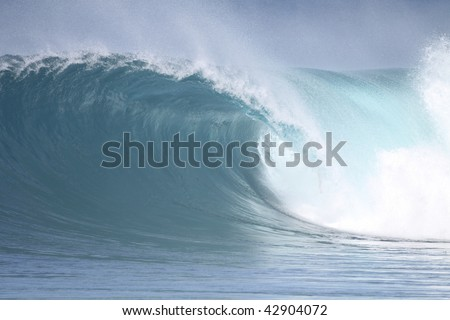 a perfect wave at Backdoor, Hawaii - stock photo