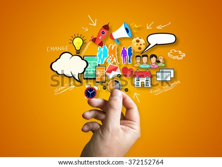 A person holding creative design elements. - stock photo