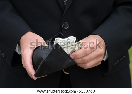 a person holds a fist full of money - stock photo