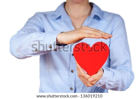a person holds a hand in its hands, isolated - stock photo