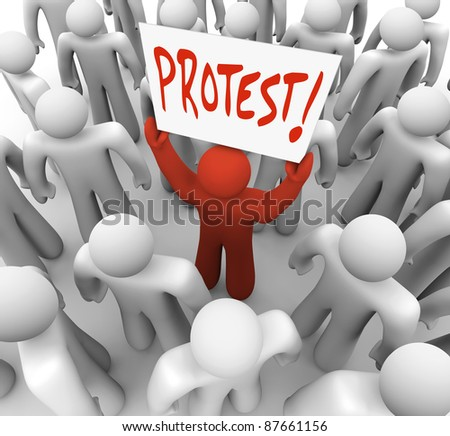 A person holds a sign reading Protest to demonstrate a complain and rally for change and revolution to demand a solution to a problem - stock photo