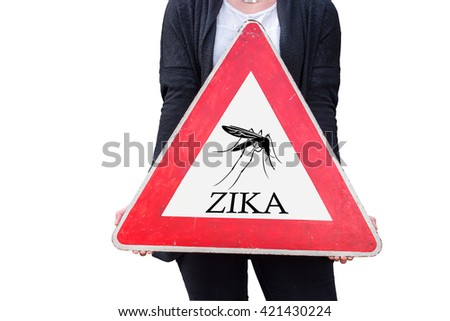 A person holds a warning sign with the inscription Zika - stock photo