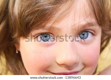 A person of European type girl, the focus is on the eyes. Close-up.