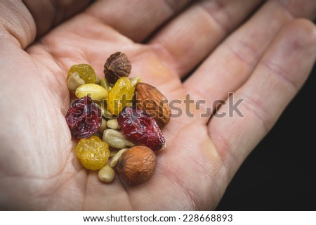 a person sharing some healthy trail mix