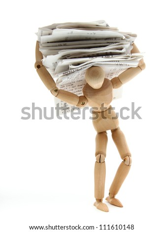 A person struggles to carry debt - stock photo