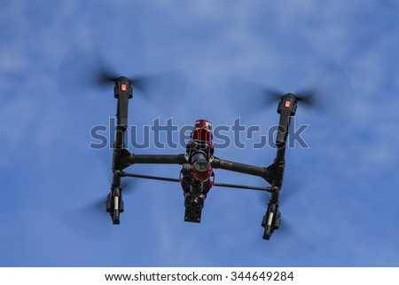 A personal drone flying through the air - stock photo