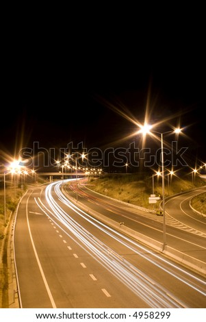 a perspective of a highway at night