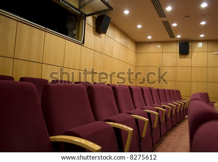 a perspective of chairs in an auditorium interior