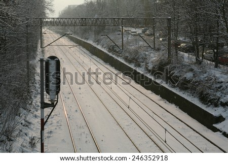 a perspective view of the railroad tracks in winter - stock photo